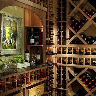 Idéer för mellanstora vintage vinkällare, med målat trägolv och vindisplay