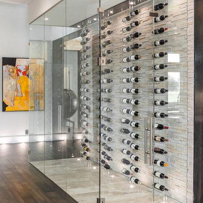 Wine cellar - small contemporary beige floor wine cellar idea in Tampa with display racks