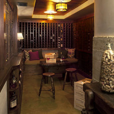 Rustic Wine Cellar by Tommy Chambers Interiors, Inc.