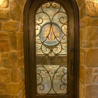 Photo of a large mediterranean wine cellar in Denver with medium hardwood flooring.