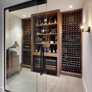 This is an example of a mid-sized contemporary wine cellar in Perth with storage racks and brown floor.