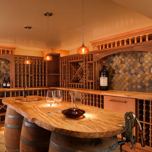 This is an example of a medium sized rustic wine cellar in Seattle with travertine flooring and storage racks.