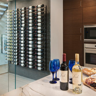 Inspiration for a medium sized contemporary wine cellar in Philadelphia with light hardwood flooring and display racks.