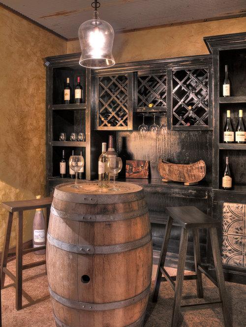 rustic wine cellar idea in minneapolis with diamond bins
