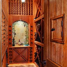 Mediterranean Wine Cellar by Sterling Custom Homes