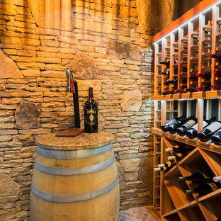 Inspiration for a medium sized rustic wine cellar in Atlanta with cube storage, brick flooring and brown floors.