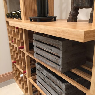 Inspiration for a small traditional wine cellar in Los Angeles with ceramic flooring and storage racks.