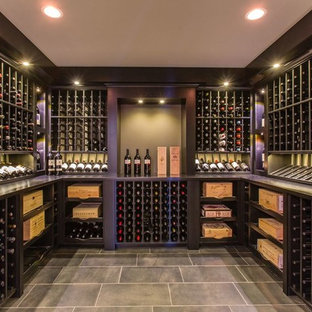 Design ideas for an expansive classic wine cellar in Orlando with display racks.