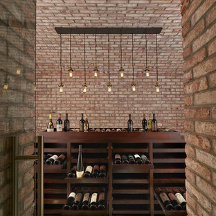 Inspiration for a mid-sized industrial wine cellar remodel in DC Metro with display racks