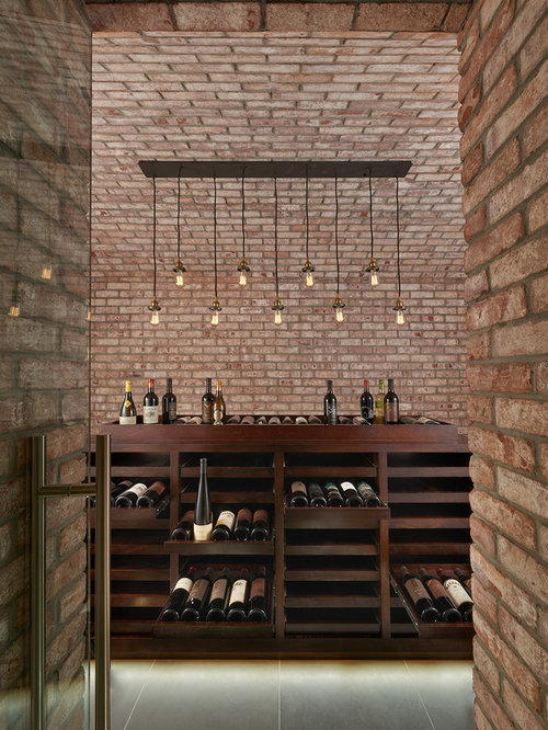 Wine Cellar Design Ideas view this great craftsman wine cellar with built in bookshelf travertine tile floors Inspiration For A Mid Sized Industrial Wine Cellar Remodel In Dc Metro With Display Racks
