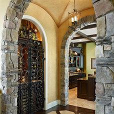 Traditional Wine Cellar by Niemann Interiors