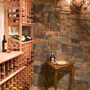 Inspiration for a rustic wine cellar remodel in Other with storage racks