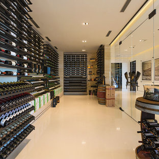 Expansive contemporary wine cellar in Los Angeles with display racks.