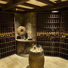 Traditional Wine Cellar by RJ Dailey Construction Co.