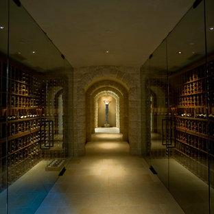 Foto på en stor funkis vinkällare, med travertin golv, vinhyllor och gult golv