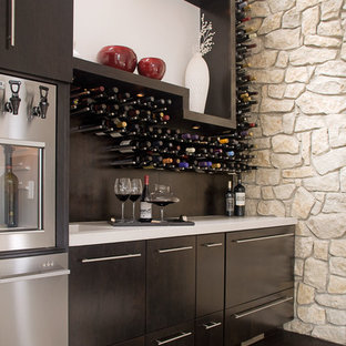 Wine cellar - contemporary dark wood floor and brown floor wine cellar idea in Other with storage racks