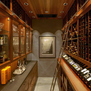 Example of a mid-sized transitional gray floor wine cellar design in Portland with storage racks