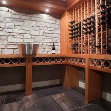 Modern Wine Cellar by PRM Custom Builders, LLC
