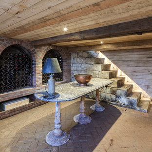 Inspiration for a medium sized rural wine cellar in Gloucestershire with storage racks and brick flooring.