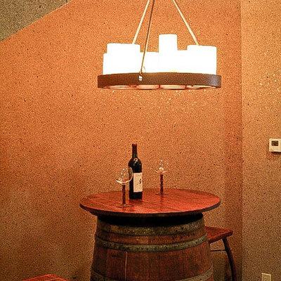 Tuscan terra-cotta tile wine cellar photo in Denver