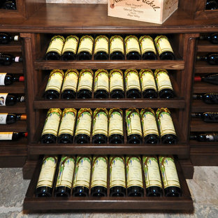 Example of a mid-sized tuscan wine cellar design in San Diego with diamond bins