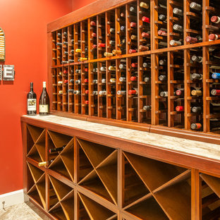 Inspiration for a small classic wine cellar in Other with ceramic flooring, cube storage and beige floors.