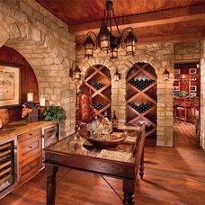 Traditional Wine Cellar by Warren Christopher Fine Floor Coverings