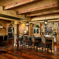 Traditional Wine Cellar by Albrecht Wood Interiors
