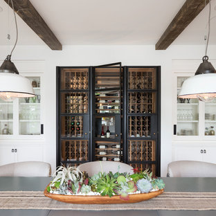 Inspiration for a transitional wine cellar remodel in Minneapolis with display racks