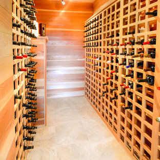 Design ideas for a large contemporary wine cellar in Other with ceramic flooring and storage racks.