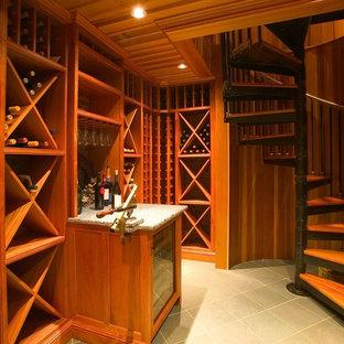 Inspiration för en mellanstor vintage vinkällare, med skiffergolv och vinställ med diagonal vinförvaring