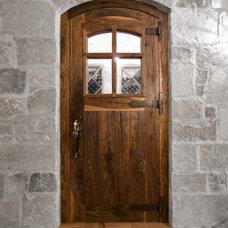 Traditional Wine Cellar by Robert J Erdmann Design, LLC