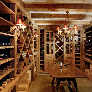 Inspiration for a large rural wine cellar in New York with storage racks, porcelain flooring and brown floors.