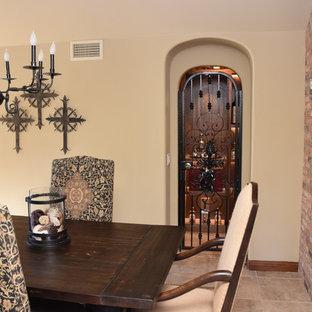 Foto de bodega romántica, pequeña, con suelo de baldosas de cerámica y vitrinas expositoras