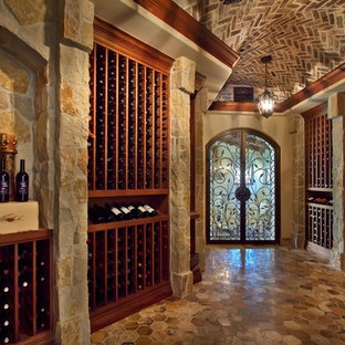 Elegant wine cellar photo in San Diego with storage racks