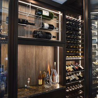 Wine cellar - large contemporary medium tone wood floor and brown floor wine cellar idea in Orange County with display racks
