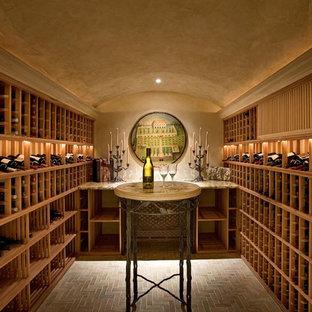 Inspiration for a mediterranean brick floor and gray floor wine cellar remodel in Santa Barbara
