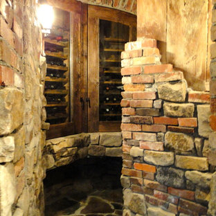 This is an example of a classic wine cellar in Denver with slate flooring and storage racks.