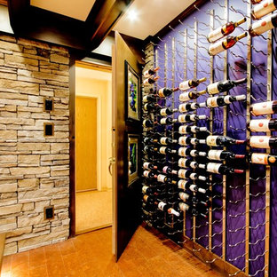 Design ideas for a traditional wine cellar in Vancouver with cork flooring and storage racks.