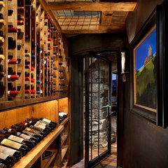 traditional wine cellar by Highline Partners, Ltd