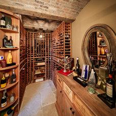 Traditional Wine Cellar by Thompson Custom Homes