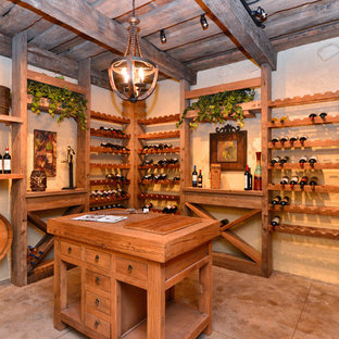 Mid-sized country wine cellar photo in Richmond with display racks