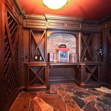 traditional wine cellar by Martin's Custom Finishing Ltd