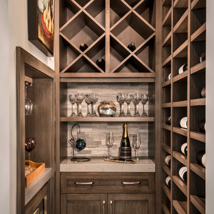 Wine cellar - small transitional porcelain floor and beige floor wine cellar idea in Miami with storage racks