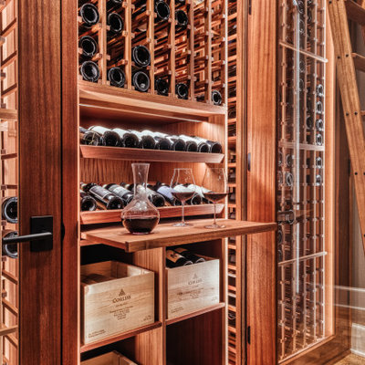 Example of a small arts and crafts cork floor wine cellar design in Portland with storage racks