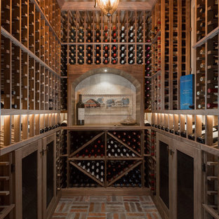 Photo of a small classic wine cellar in Phoenix with brick flooring and storage racks.