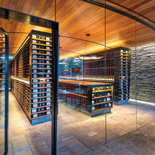 This is an example of a modern wine cellar in Other.