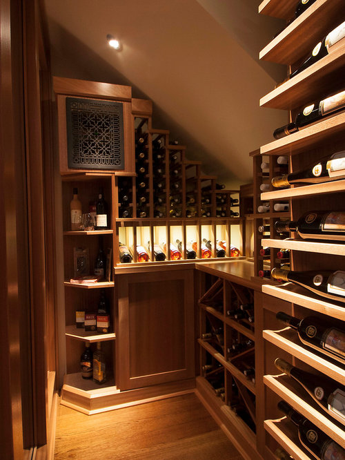 example of a transitional wine cellar design in toronto with medium