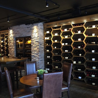 Large arts and crafts wine cellar photo in San Francisco with display racks