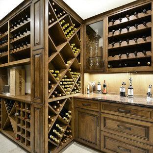 Idéer för att renovera en mellanstor vintage vinkällare, med vinställ med diagonal vinförvaring och travertin golv